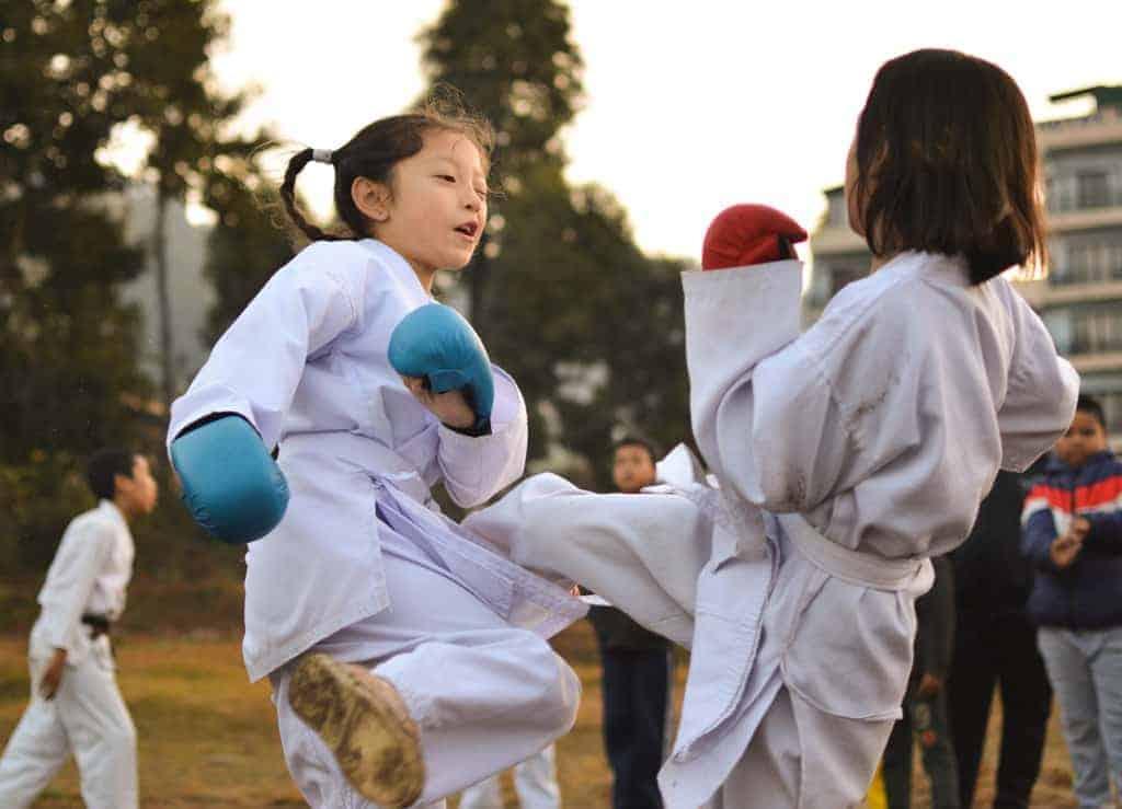 Two kids fighting Kumite